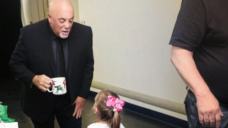 Joel talks to his daughter Della backstage at