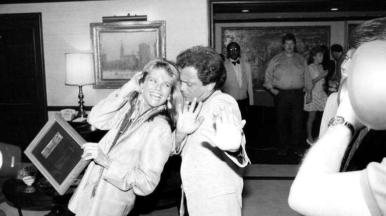 Billy Joel dances with then-girlfriend Christie Brinkley as
