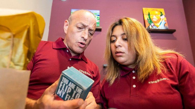 Team leader Steve Arzt helps store clerk Dinora