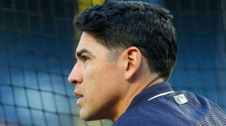 Jacoby Ellsbury of the Yankees looks on during