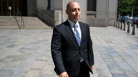 Adam Skelos, son of Dean Skelos, walks from