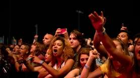 Fans cheer as Sublime with Rome performs during