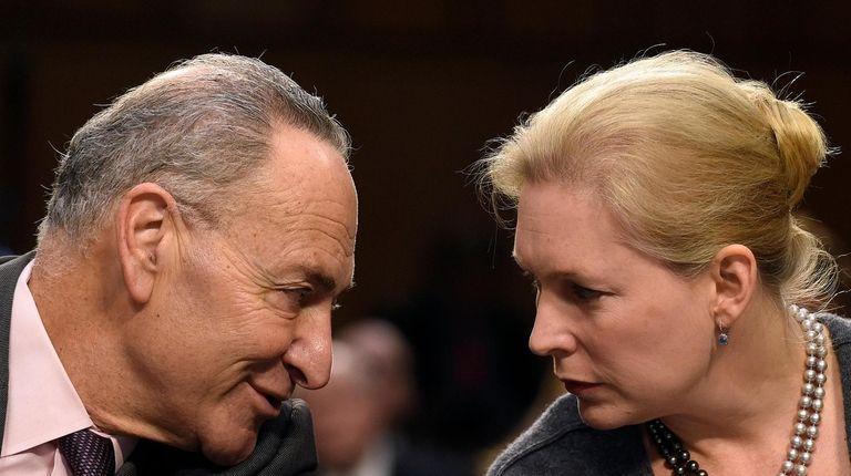 Sen. Charles Schumer talks with Sen. Kirsten Gillibrand