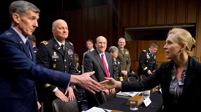 Sen. Kirsten Gillibrand greets Lt. Gen. Richard Harding,