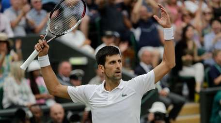 Novak Djokovic gestures after winning a point during