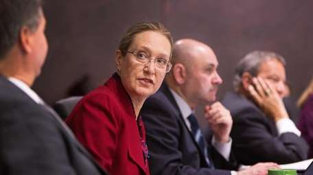 Legislator Bridget Fleming speaks to Legislator Al Krupski,