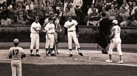 Reggie Jackson is greeted at home plate