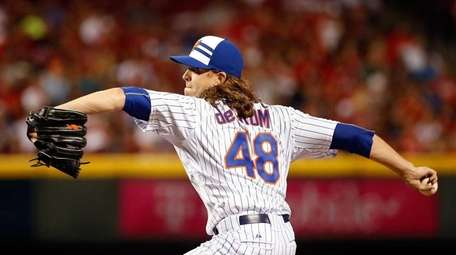 National League All-Star Jacob deGrom throws a pitch
