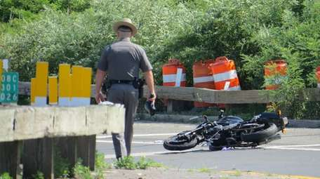 A state trooper on scene of fatal motorcycle
