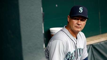 Seattle Mariners manager Scott Servais sits in the