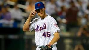 Zack Wheeler of the Mets walks to the