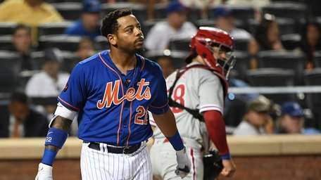 Mets first baseman Dominic Smith reacts after he