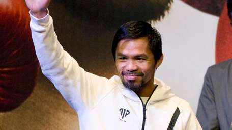 Philippine senator and boxing hero Manny Pacquiao waves