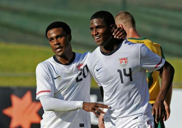 Edson Buddle, right, is congratulated by teammate Robbie