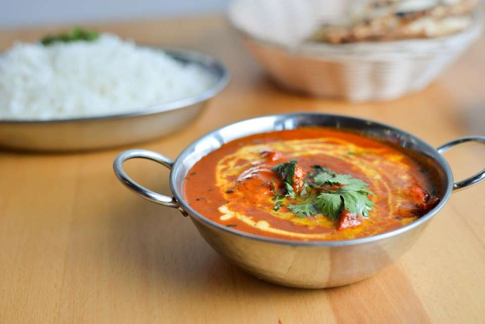 Chicken tikka Masala is served with naan and