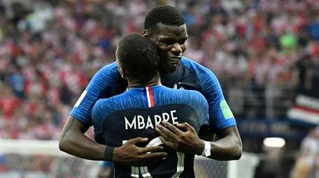 France's Kylian Mbappe, front, celebrates with Paul Pogba