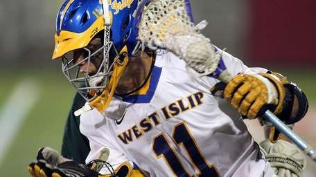 West Islip's Andrew Hodgson (11) drives to the