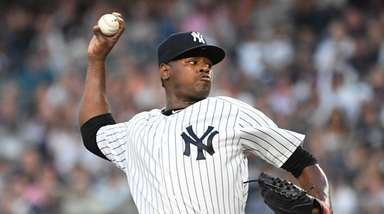 Yankees starting pitcher Luis Severino delivers a pitch