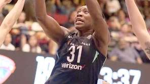 Liberty's Tina Charles gets the basket against the
