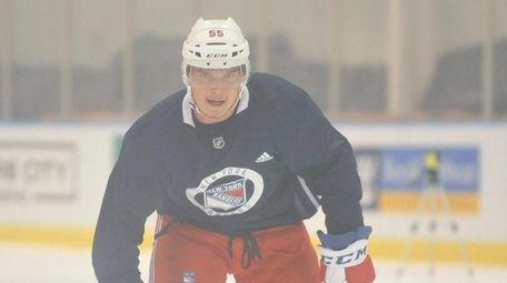 Ryan Lindgren skates during Rangers prospect camp at