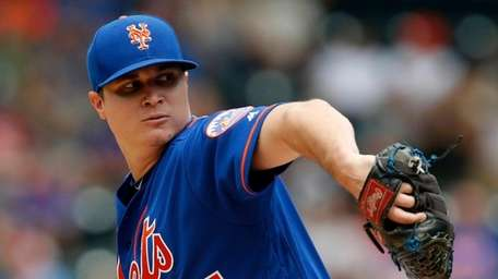 Corey Oswalt of the Mets pitches in the