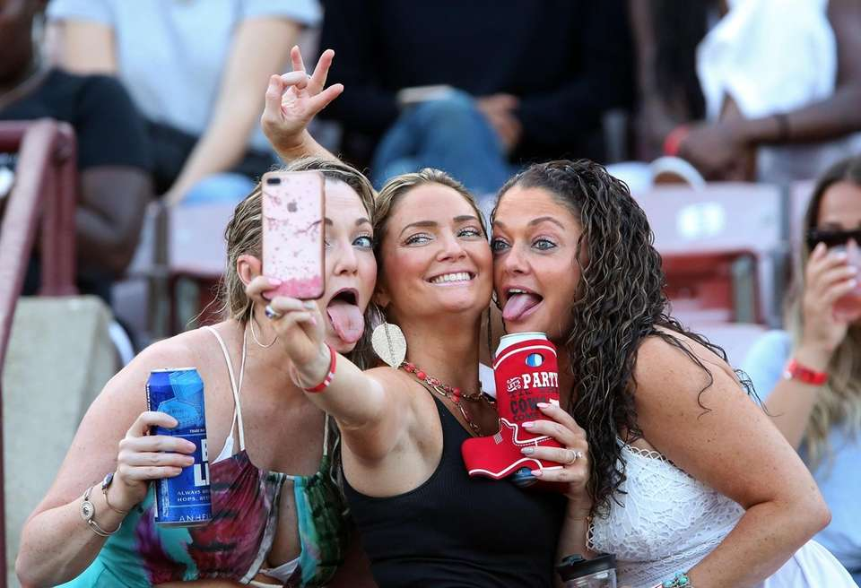 Fans take a selfie at the Lauryn Hill