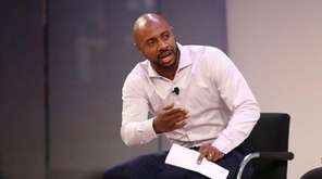 Jay Williams, left, moderates a discussion with NHL