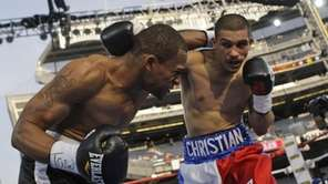 Jonathan Cuba, left, fights Christian Martinez, right, during