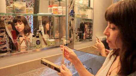 Nicole Lentini explains the bamboo toothbrush which is