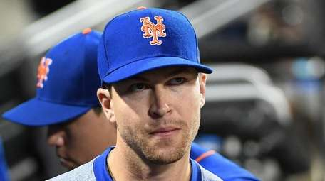 Mets pitcher Jacob deGrom leaves the dugout after