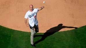 Former Dodgers outfielder Kirk Gibson throws the ceremonial