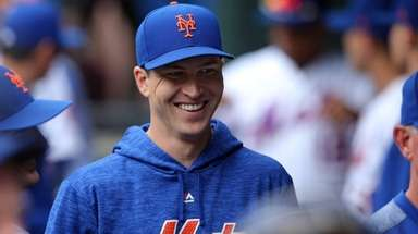 Mets starting pitcher Jacob deGrom smiles in the