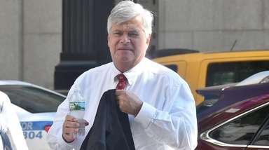 Dean Skelos arrives at the federal courthouse in