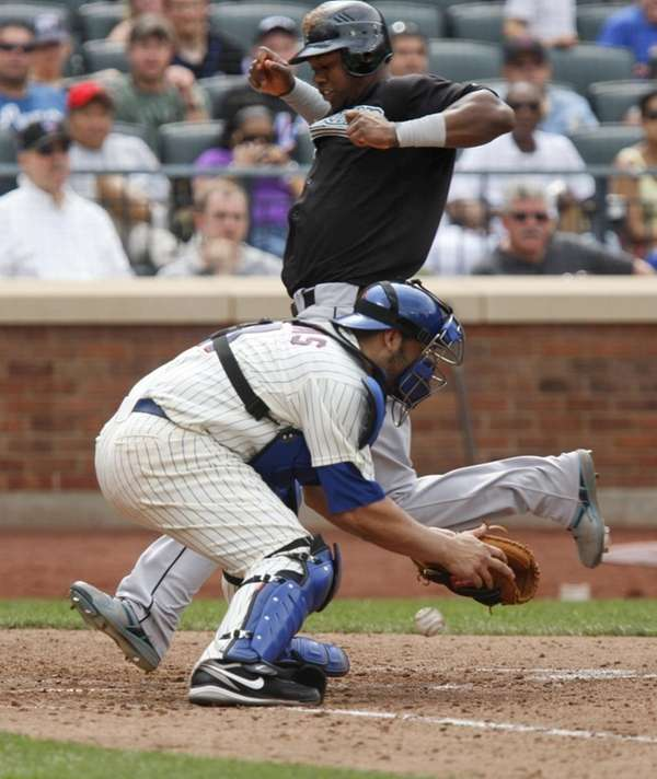 Florida Marlins' Hanley Ramirez, top, crosses home plate