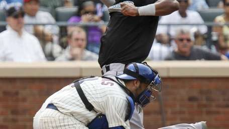 Florida Marlins' Hanley Ramirez, top, crosses home plate