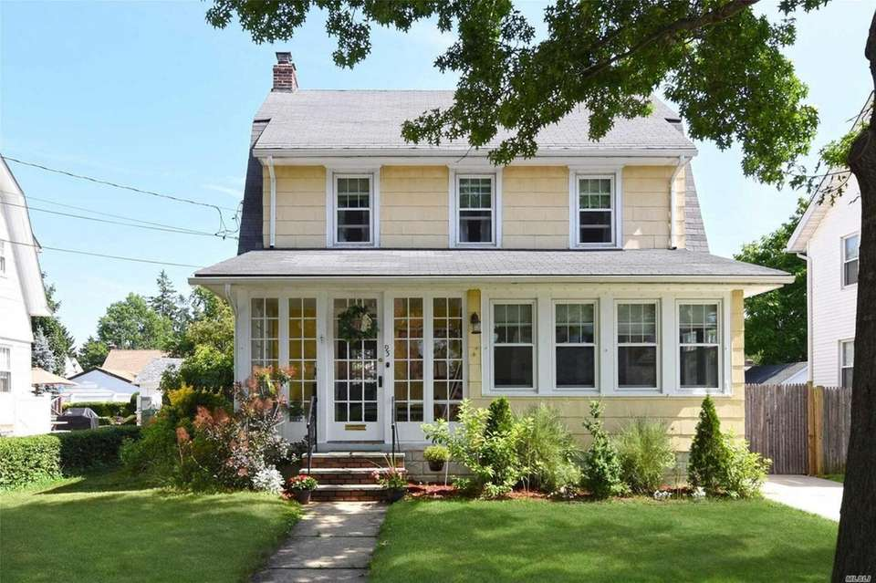 This East Rockaway Colonial includes three bedrooms and