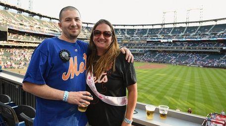 Mike Angora and his fiancée Krystal Baker pose