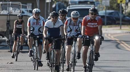 Huntington Bicycle Club members ride on Mill Dam