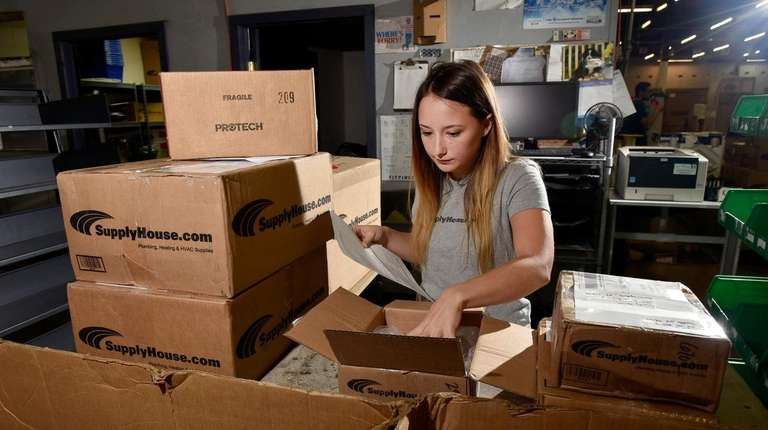 Melville-based SupplyHouse.com employee Emily Fitzgibbon checks shipments at
