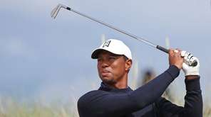 Tiger Woods tees off on the sixth hole