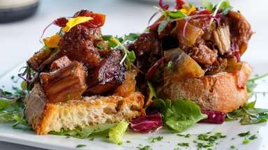 Eggplant caponata served atop crostini is a savory,