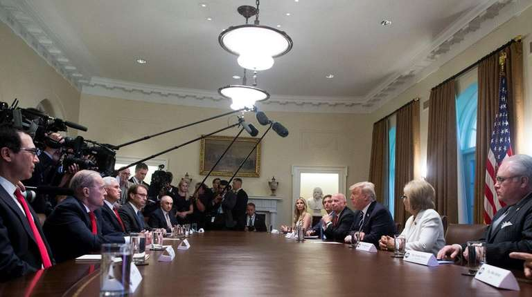 President Donald Trump meets with members of Congress