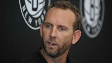 Nets general manager Sean Marks speaks with the