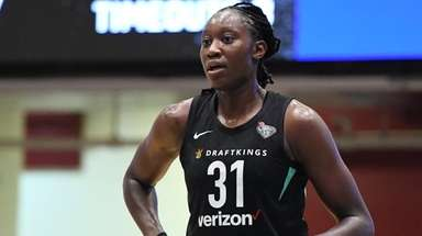 Tina Charles of the Liberty looks on during