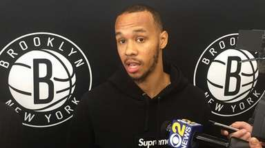 Shabazz Napier of the Nets speaks with the