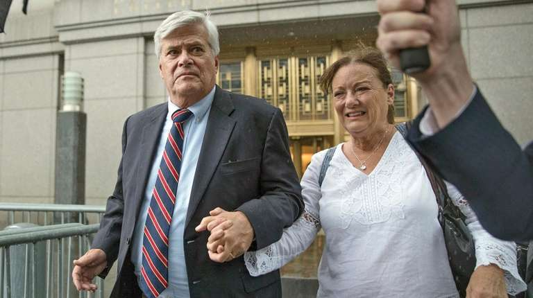 Dean Skelos, left, and his wife Gail leave