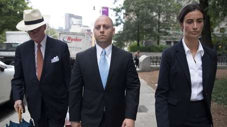 Adam Skelos, center, leaves federal court on Tuesday
