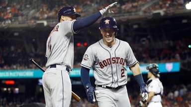 The Astros' George Springer congratulates teammate Alex Bregman
