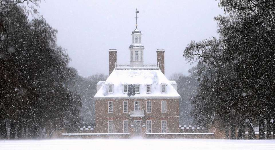 Snow falls over the Governor's Palace in Colonial