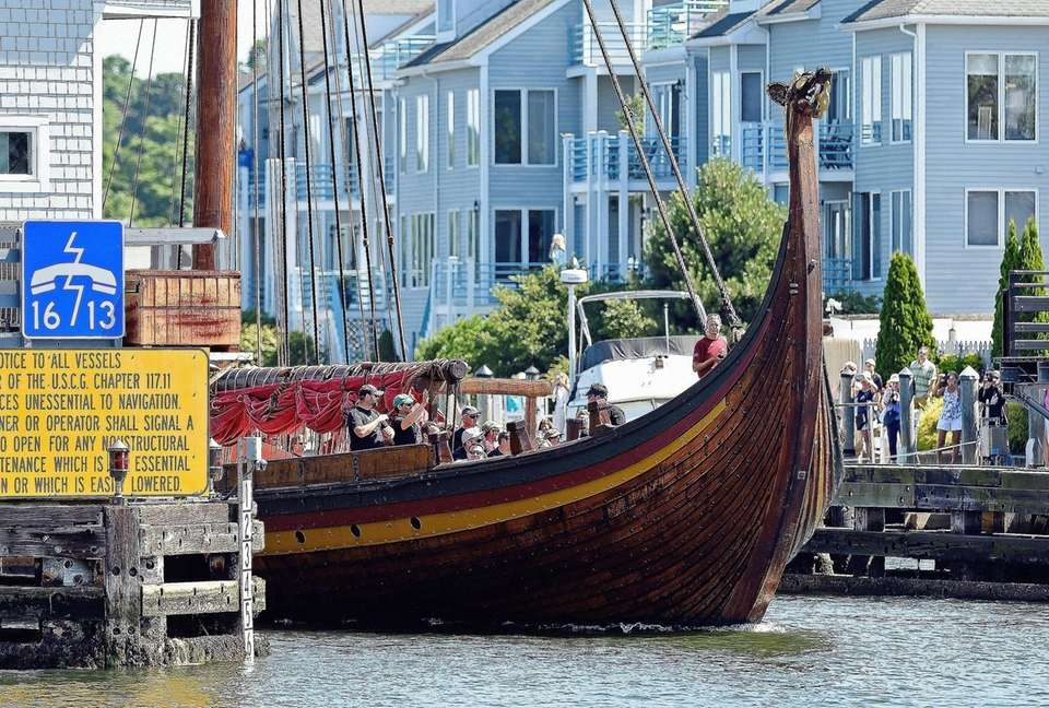 The replica Viking ship Draken Harald Harfagre passes